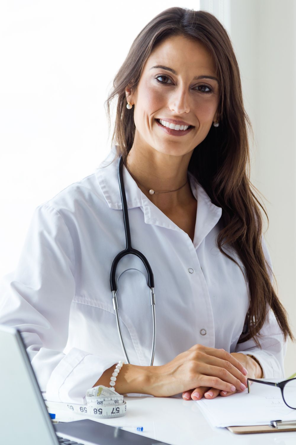 beautiful-young-female-doctor-looking-at-camera-in-the-office