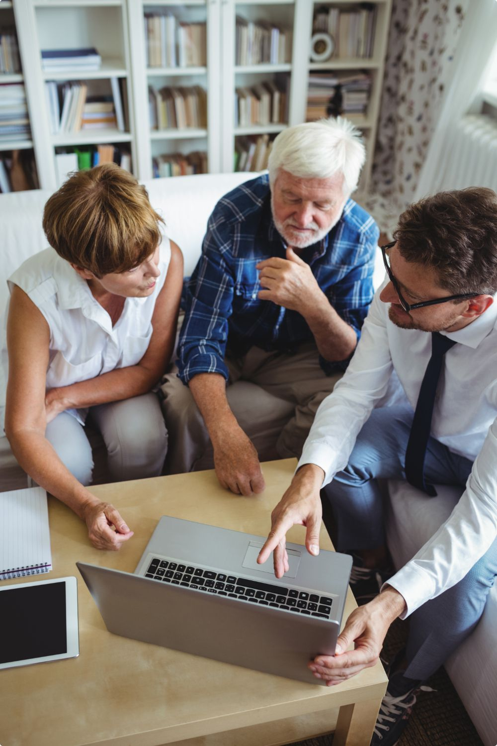 senior-couple-planning-their-investments-with-financial-advisor